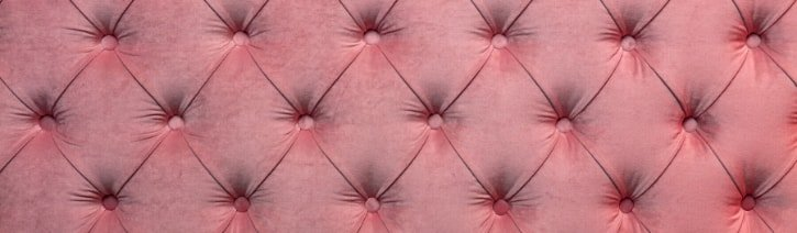 Image of a pink diamond tufted headboard.