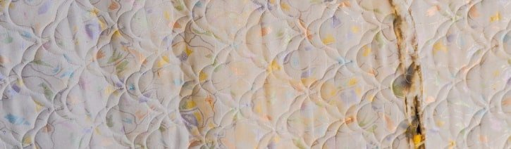 Image of a stained mattress.