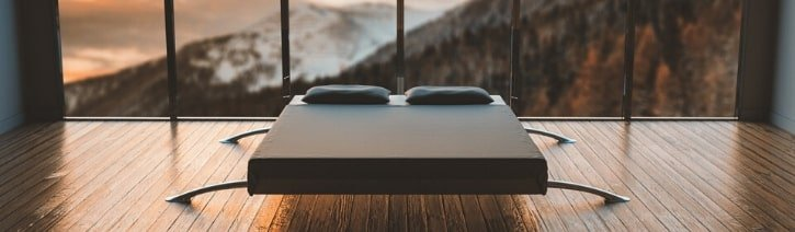 Picture of a bed in a bedroom.