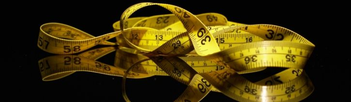 Tape measure for measuring mattress and bed sheet dimensions.
