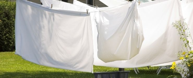 Washed Bed Sheets Drying Outside