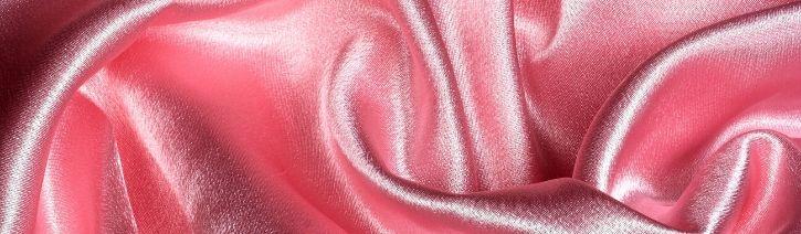 Pink satin bed sheet.