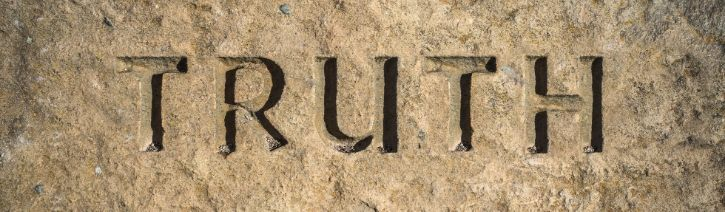 The word 'Truth' carved into stone.