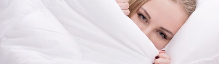 Woman sleeping in Egyptian cotton sheets.