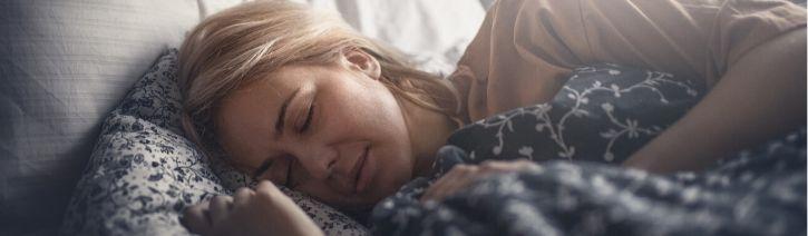 Woman sleeping on a Zinus mattress.