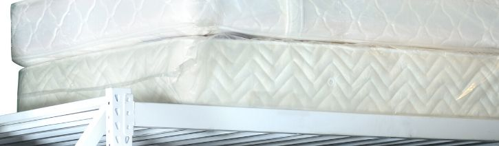 Mattresses stacked on top of each other.