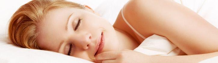 Woman Sleeping on a Milliard Memory Foam Mattress.