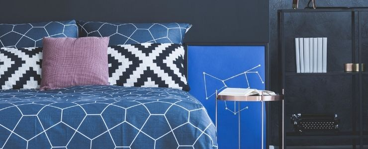 Cracked Blue Bedding With Dark Gray Walls