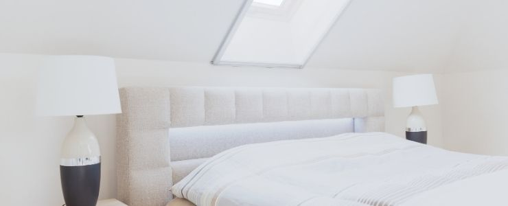 Attic Bedroom With Headboard and Slanted Wall
