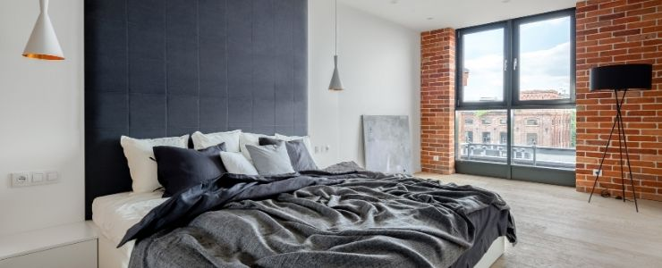 Brick and Upholstered Bedroom Wall Style.