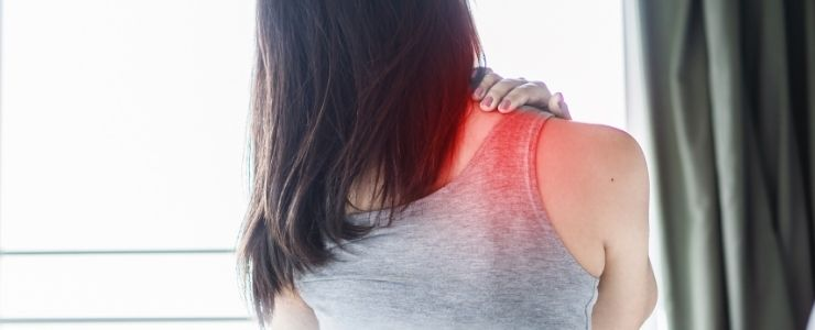 Woman With Frozen Shoulder Pain in Bed.