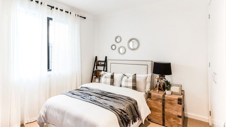 Two Tone Small Bedroom With White Walls and Wood Tones