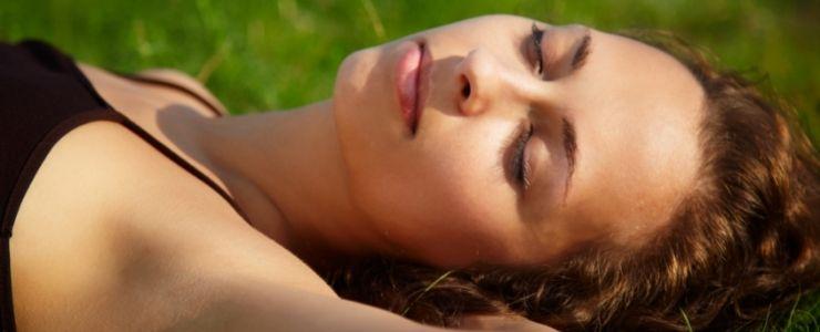 Woman sleeping with sunburn.