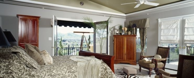 African Themed Bedroom With Carved Furniture