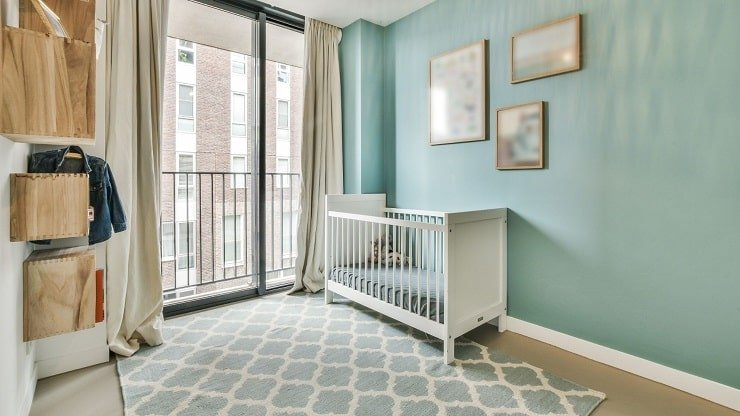 Child's Small Bedroom With Integrated Carpets and Curtains