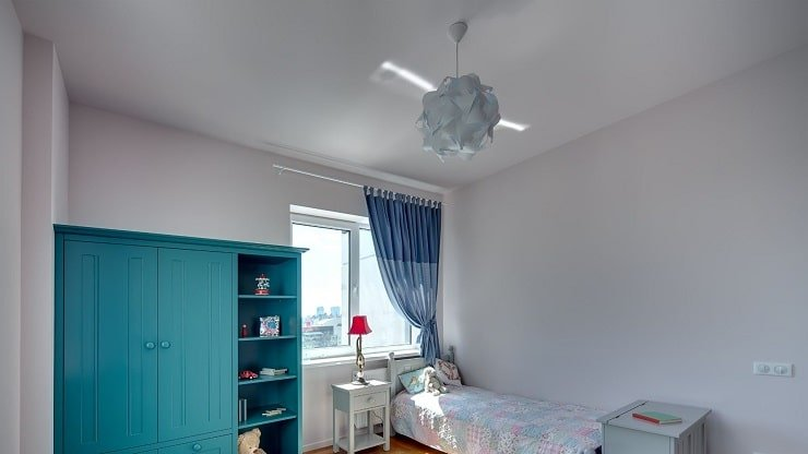 Kid's Small Bedroom With Fancy Ceiling Light