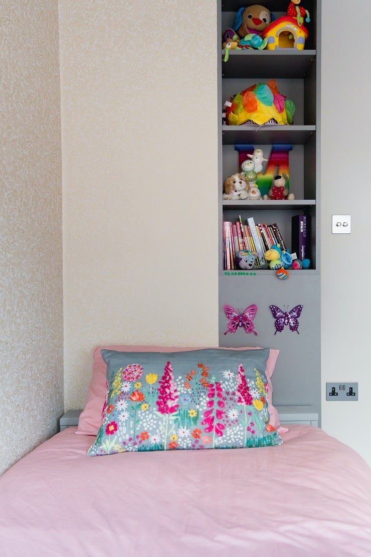 Boy's Small Bedroom With Bookshelves